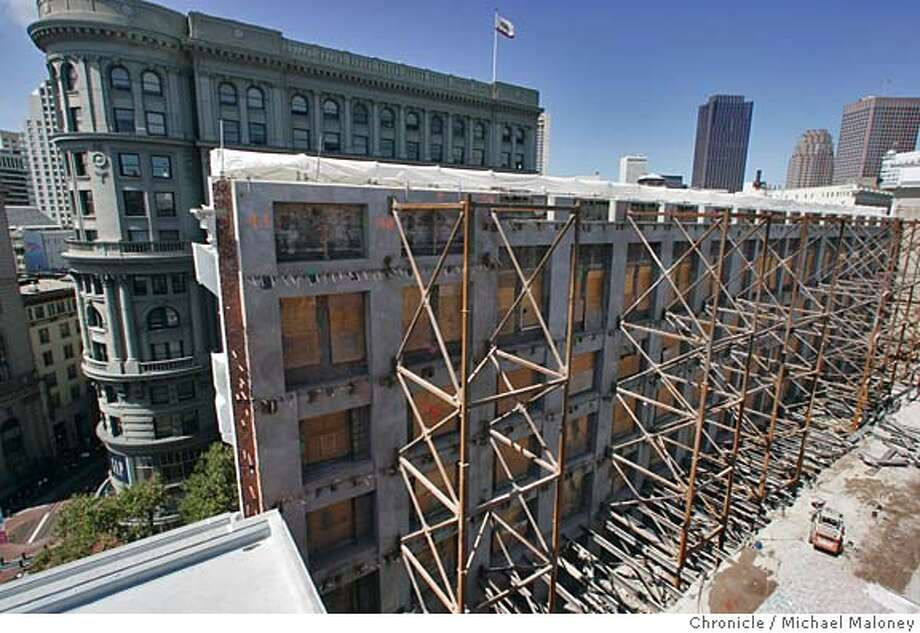 Steel girders support the brick facade of the old Emporium facing Market Street (across the street from the James C. Flood Building, seen in upper left). The facade will remain as will the historic dome.  Construction of Bloomingdale's, part of the expanded Westfield San Francisco Centre continues as the last part of the old Emporium building is set to be demolished. The brick facade (facing Market Street) and the 100 foot wide historic dome will be all that remains of the old Emporium as the new store is built beneath and around them. The new 1.5 million square-foot, $410 million project will feature a mix of 200 specialty stores, dining establishments, an international gourmet marketplace, office space and a nine screen auditorium complex. The project is scheduled to open in 2006  Photo by Michael Maloney / San Francisco Chronicle Photo: Michael Maloney