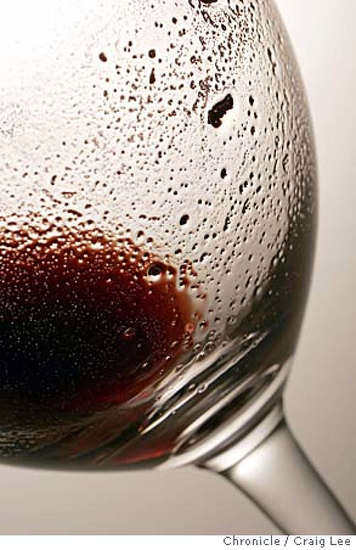 Photo of wine sediment alongside inside a wine glass. Event on 8/31/04 in San Francisco. Craig Lee / The Chronicle