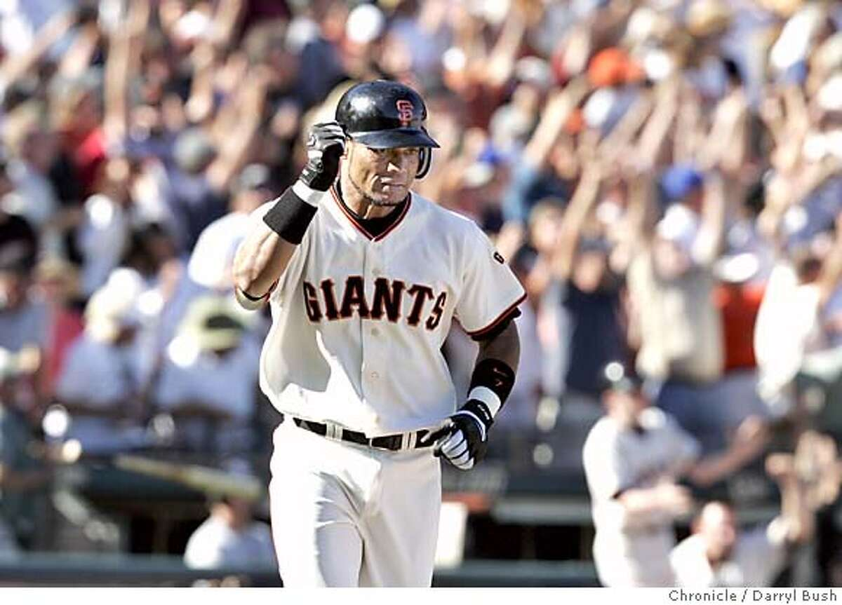 giants26_003_db.jpg San Francisco Giants Pedro Feliz raises his fist while running after he hit a grand slam home run vs. the Los Angeles Dodgers in the eighth inning at SBC Park. 9/25/04 in San Francisco Darryl Bush / The Chronicle Ran on: 01-18-2005 Brandy Hazelett at her spot on Van Ness and Golden Gate MANDATORY CREDIT FOR PHOTOG AND SF CHRONICLE/ -MAGS OUT