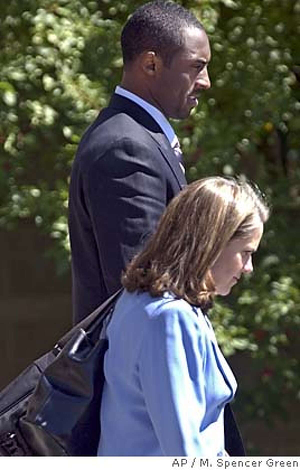 L.A. Lakers' star Kobe Bryant talks with his attorney Pamela Mackey as he leaves court at the Justice Center Wednesday, Sept. 1 2004 in Eagle, Colo. after a half day in the jury selection phase of his sexual assault trial. (AP Photo/M. Spencer Green)