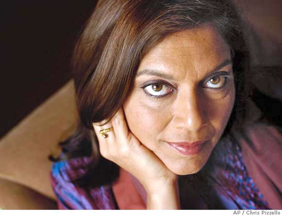 """Director Mira Nair poses at the L'Ermitage Hotel in Beverly Hills, Calif., Monday, Aug. 23, 2004. Her new movie, """"Vanity Fair,"""" opens on Sept. 1.(AP Photo/Chris Pizzello) Photo: CHRIS PIZZELLO"""