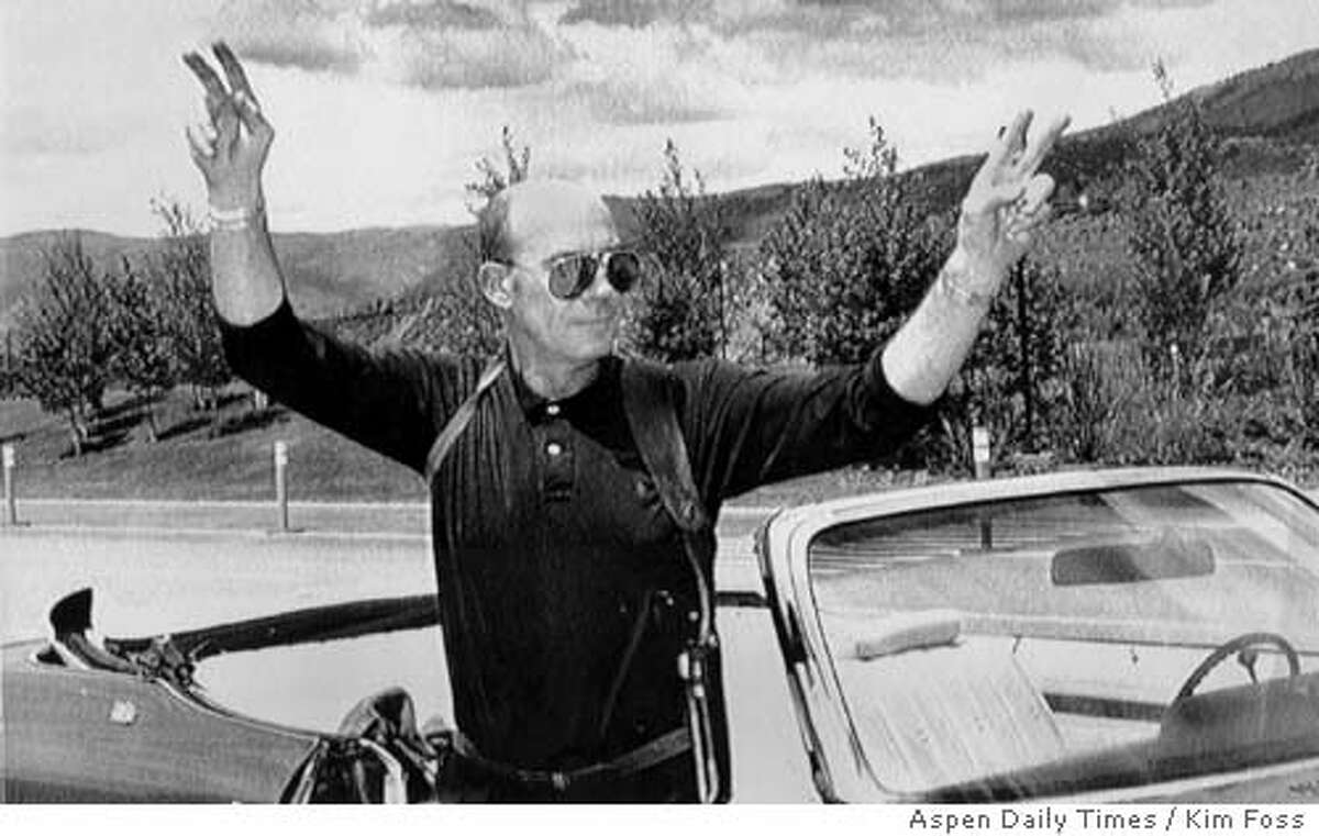 File photo of Hunter S. Thompson. 1990 Gonzo Journalist, Hunter S. Thompson flashes the victory sign in Aspen, Co., on Wednesday, May 30, 1990, after learning that Pitkin County, Co., prosecutors planned to drop felony charges against Thompson for possession of explosives and narcotics along with sexual assault charges. A judge formally dismissed the case Thursday afternoon. Kim Foss/ Aspen Times Daily via AP