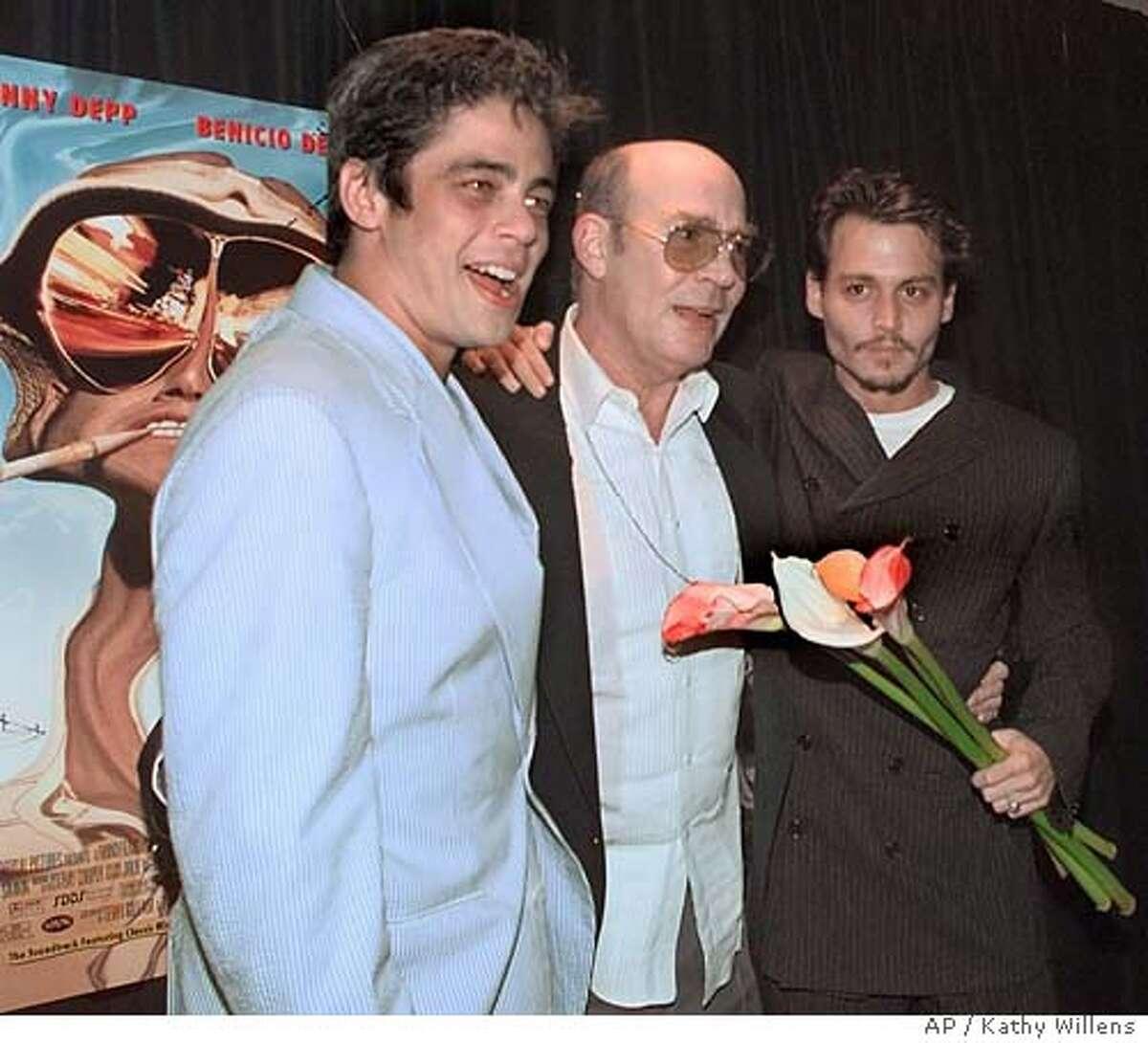 Co-stars Benicio Del Toro, left, and Johnny Depp, right, join Hunter Thompson, center, author of the classic pop culture novel