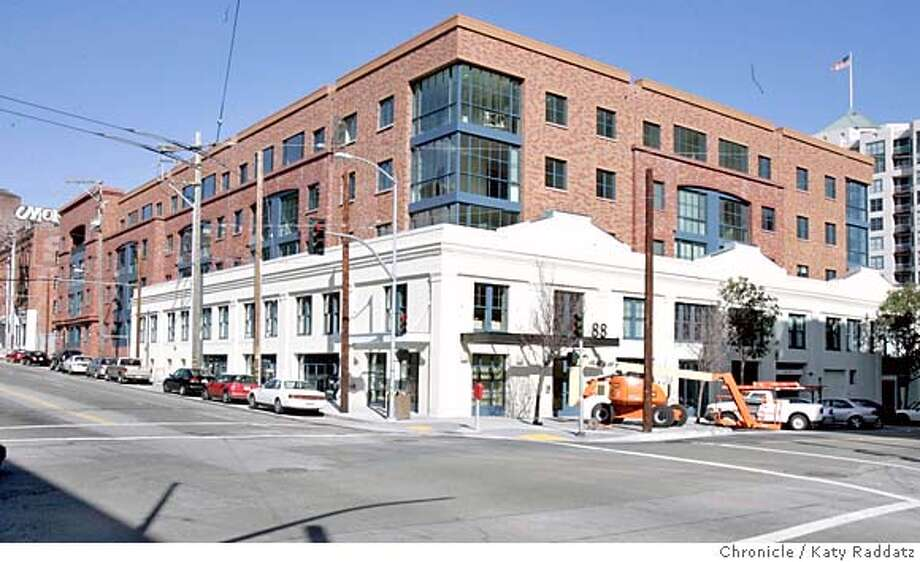 PRESERVATIONxx004_RAD.JPG Story is about how front walls of old buildings are kept intact while new buildings are stuck behind them, often in jarring and ungainly ways. SHOWN: 88 Townsend, corner of 2nd and Townsend Sts., where an old white warehouse now has a five story red condo complex jumping up in the rear. Photo taken on 2/6/05, in SAN FRANCISCO, CA.  By Katy Raddatz / The San Francisco Chronicle MANDATORY CREDIT FOR PHOTOG AND SF CHRONICLE/ -MAGS OUT Photo: Katy Raddatz