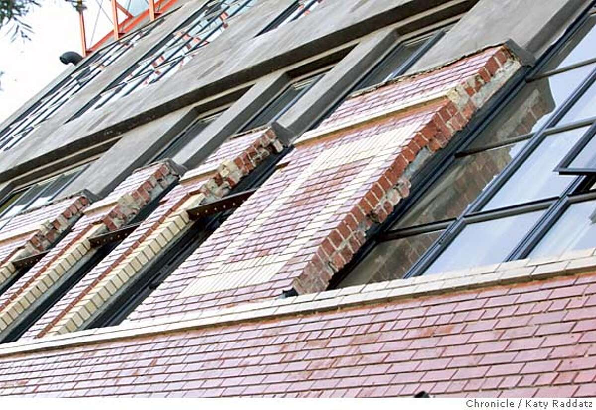 PRESERVATIONxx017_RAD.JPG Story is about how front walls of old buildings are kept intact while new buildings are stuck behind them, often in jarring and ungainly ways. SHOWN: 1233 Howard St. where a black concrete addition has been slapped atop old bricks so rudely that you can see broken bricks on the second floor hacked apart to make windows wider. Photo taken on 2/6/05, in SAN FRANCISCO, CA. By Katy Raddatz / The San Francisco Chronicle MANDATORY CREDIT FOR PHOTOG AND SF CHRONICLE/ -MAGS OUT