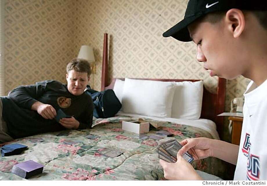 KEN HO(IN CAP), A PLAYER OF THE CARD GAME 'MAGIC THE GATHERING', PRACTICES THE GAME IN A SAN FRANCISCO HOTEL ROOM WITH BEN RUBIN. Event on 8/31/04 in SAN FRANCISCO. S.F. Chronicle Photo: Mark Costantini Photo: Mark Costantini