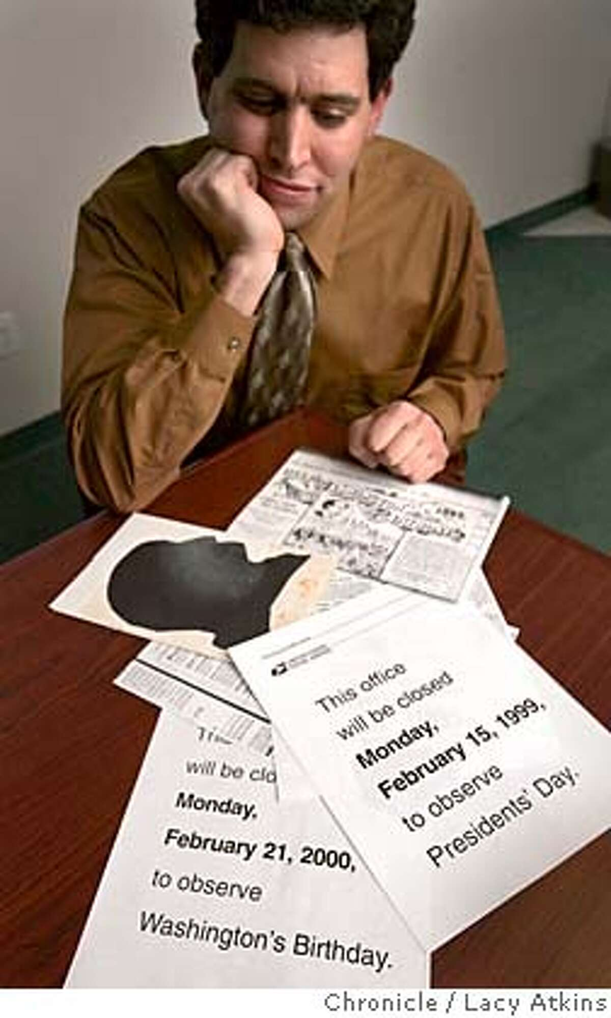 Jason Bezis, shows the papers he has collected showing both Washington's Birthday and President's Day, Wed. feb,16,05, in San Francisco.Jason Bezis, a lawyer from Lafayette, is on a crusade to have Washington's Birthday be called Washington's Birthday rather than Presidents Day. It's officially Washington's Birthday, but apparently there's been a popular cultural shift. Photographer Lacy Atkins / San Francisco Chronicle