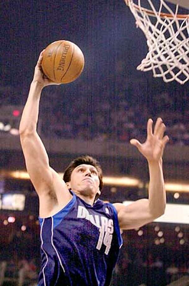 ** FILE ** Dallas Mavericks Eduardo Najera, of Mexico, soars through the air to slam dunk the ball against the Phoenix Suns in the first quarter in this March 13, 2004 photo, in Phoenix. The Dallas Mavericks got a big man, completing an eight-player deal Tuesday that will bring Erick Dampier from Golden State. Dallas sent Christian Laettner, Eduardo Najera, two future first-round draft picks and the draft rights to guards Luis Flores and Mladen Sekularac to the Warriors for Dampier, Dan Dickau, Evan Eschmeyer and the draft rights to Steve Logan. (AP Photo/Paul Connors) Ran on: 08-26-2004  Eduardo Najera, who was obtained from the Mavericks, is expected to share time at small forward with Mike Dunleavy. Ran on: 08-26-2004  Eduardo Najera, who was obtained from the Mavericks, is expected to share time at small forward with Mike Dunleavy. Ran on: 08-26-2004  Eduardo Najera, who was obtained from the Mavericks, is expected to share time at small forward with Mike Dunleavy. Photo: PAUL CONNORS