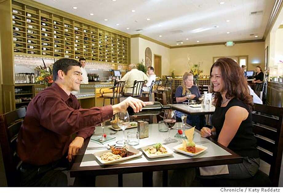 WHATSNEW01016_rad.jpg The Wine Garden restaurant at 6476 Washington St. in Yountville, CA. SHOWN: John Savage and Kandice McGarvey prepare to enjoy a meal of little plates. Foreground dishes are: Grilled Stuffed Quail with Bourbon Barbeque Saude and Hoppin' John, Grilled Day Boat Scallops with White Corn Succotash, Ahi Tuna Tartarte with Yellow and Red Gaspacho Sauce and Cucumber and Celery Seed Crackers. Katy Raddatz / The Chronicle Photo: Katy Raddatz