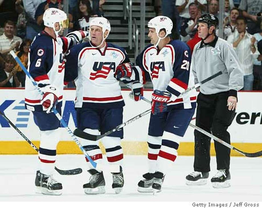 COLUMBUS, OH - AUGUST 27: Brett Hull #16 (C) of team USA is congratulated by teammates Eric Weinrich #6 (L) and Ken Klee #20 (R) after scoring a goal during the first period of an exhibition game against team Russia in the World Cup of Hockey on August 27, 2004 at Nationwide Arena in Columbus, Ohio. The USA won 2-0. (Photo by Jeff Gross/Getty Images) *** Local Caption *** Brett Hull;Eric Weinrich;Ken Klee Ran on: 08-30-2004  Brett Hull is congratulated by Eric Weinrich (6) and Ken Klee (20) after scoring for the U.S. in a World Cup exhibition against Russia. Ran on: 08-30-2004  Brett Hull is congratulated by Eric Weinrich (6) and Ken Klee (20) after scoring for the U.S. in a World Cup exhibition against Russia. Photo: Jeff Gross