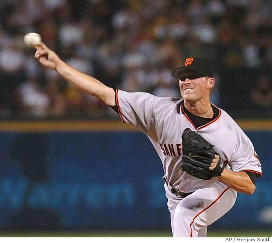 San Francisco Giants starter Brad Hennessey delivers to the Atlanta Braves during the second inning Sunday, Aug. 29, 2004, at Turner Field in Atlanta. (AP Photo/Gregory Smith) Photo: GREGORY SMITH