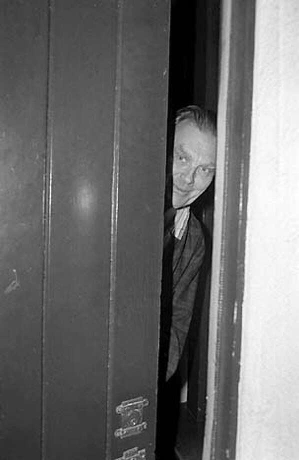 Nobel Prize winner Czeslaw Milosz talks to reporters through a crack in the door during an early morning interview following the announcement that he had won the 1980 Nobel Prize in literature. Milosz, an exiled Polish poet and novelist, is professor of Slavic languages at the University of California at Berkley. (AP Photo/Jim Palmer) Photo: STF