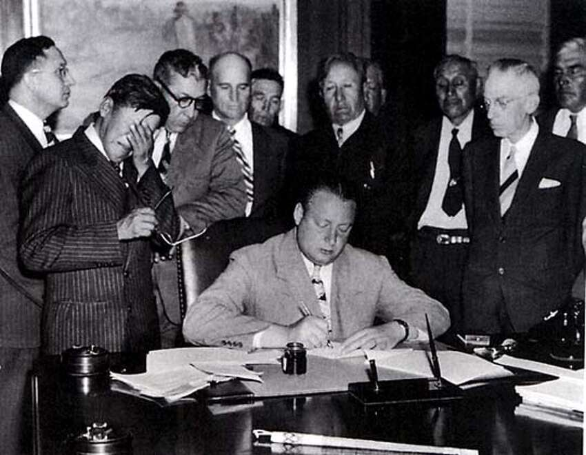 Tribal chairman George Gillette weeps at the 1949 signing of a bill that would flood the ancestral home of the Mandan, Hidatsa, and Arikara people.