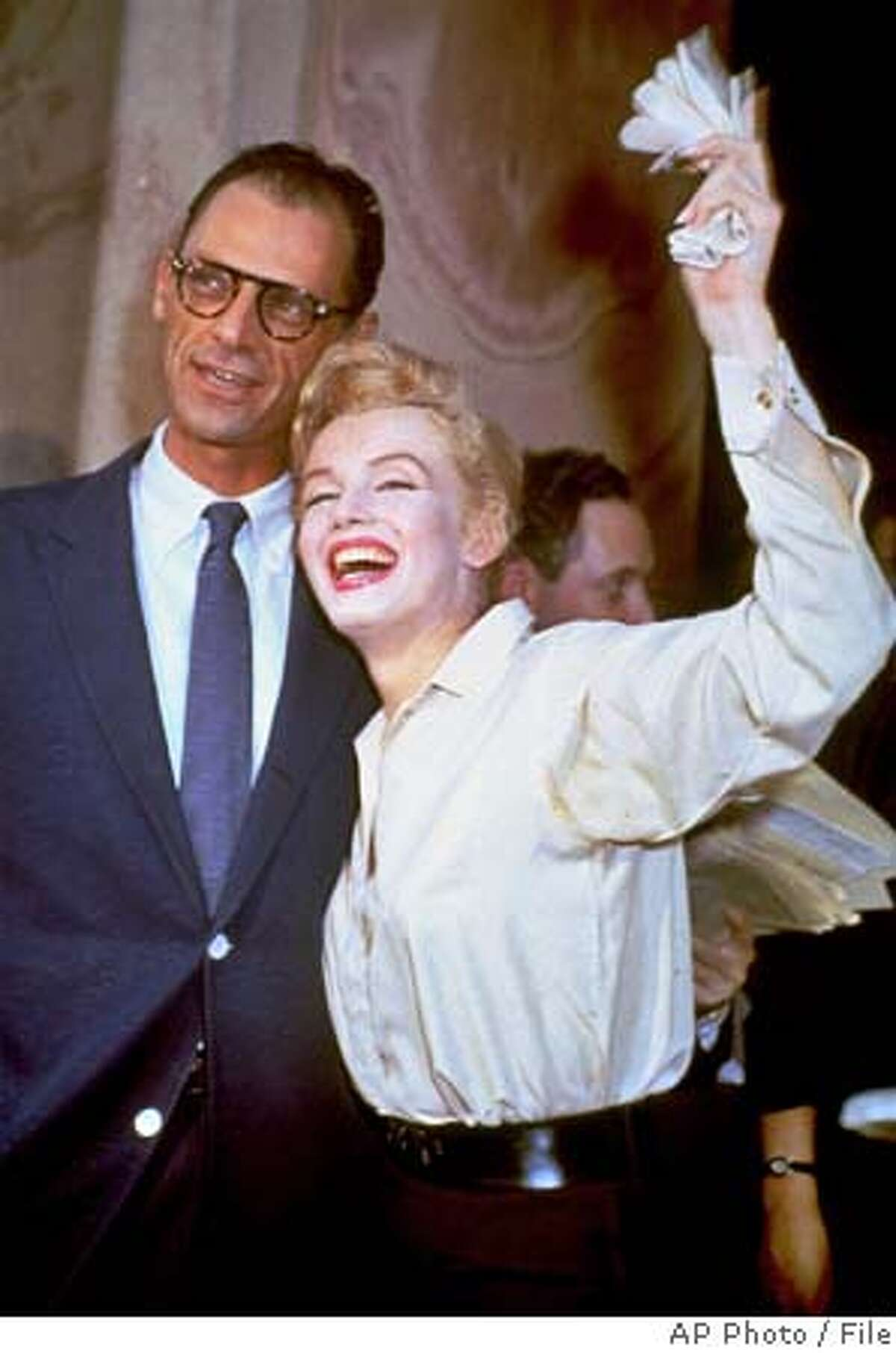 **FILE**Newlyweds Marilyn Monroe and Arthur Miller are shown after their civil wedding ceremony in White Plains, N.Y., on June 29, 1956. Miller, the Pulitzer prize-winning playwright whose most famous fictional creation, Willy Loman in