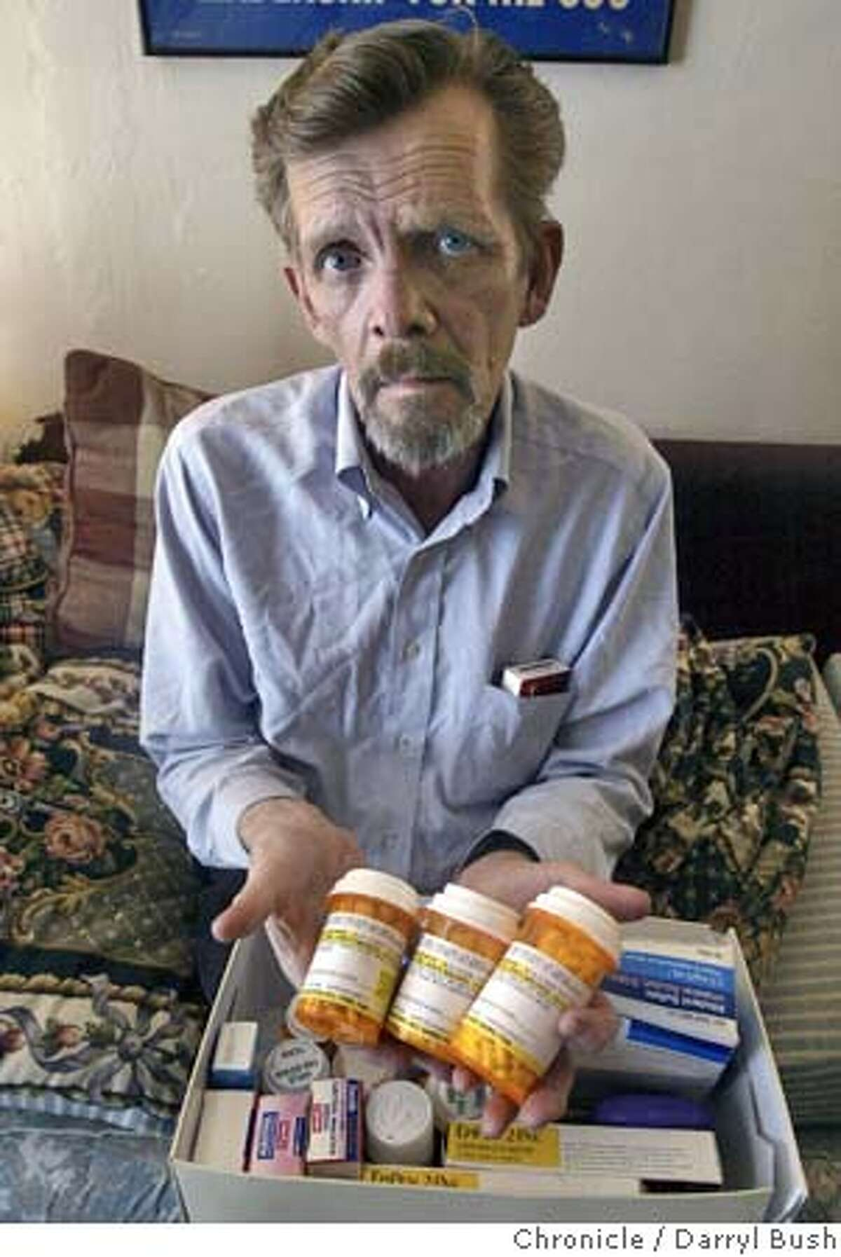 James Malone, in his home, holds some of the medications he took to help him manage some of the symptons of HIV. Malone wasn't perscribed any direct AIDS medications. Malone was misdiagnosed as HIV positive several years ago, and found out recently he is HIV negative. 8/24/04 in Hayward Darryl Bush / The Chronicle