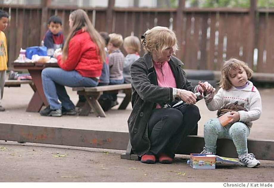 BANKRUPTCY_031_KW.jpg  On 2/14/05 While the other preschoolers eat lunch in the background, Dr. Jeanie Brewer, MD, who is contemplating bankruptcy due to the accumulated medical bills for her daughters diabetic condition, tests her daughter, Lara Montero's, 3, blood sugar levels at the New School preschool in Berkeley Monday afternoon. Kat Wade/ The Chronicle MANDATORY CREDIT FOR PHOTOG AND SF CHRONICLE/ -MAGS OUT Photo: Kat Wade