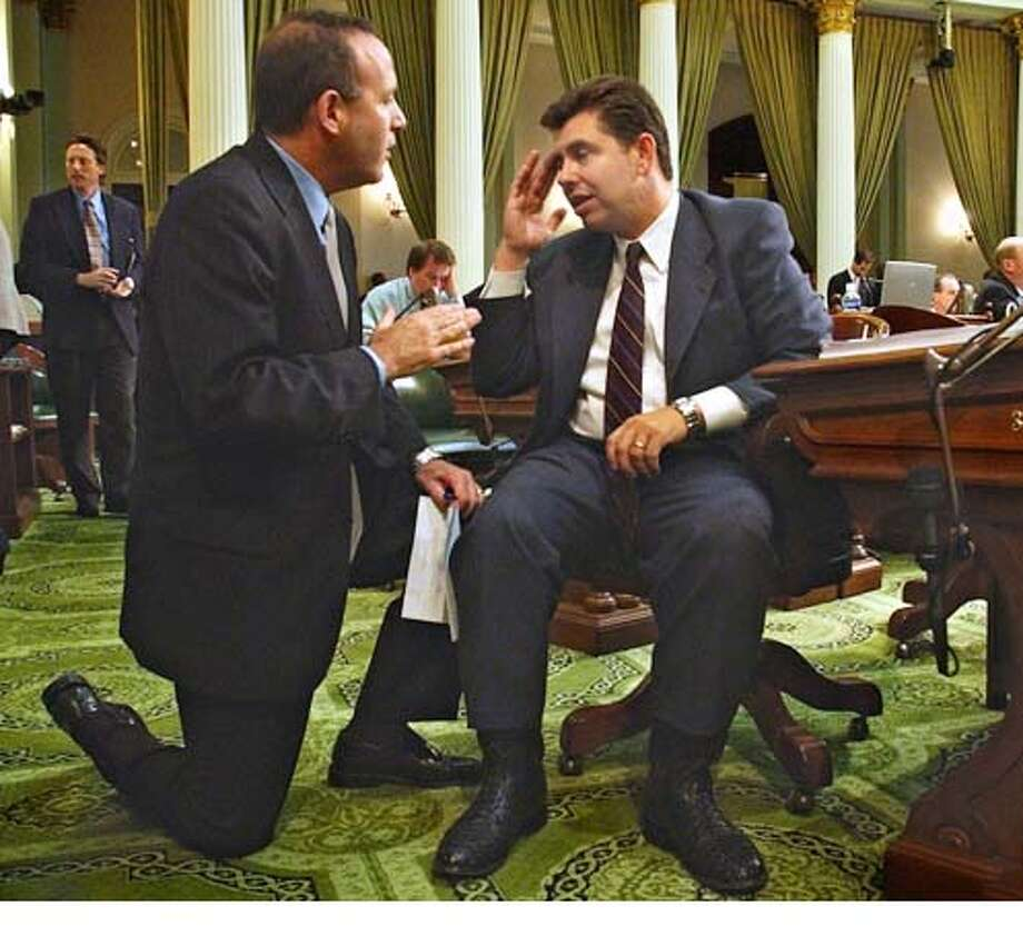 Assemblyman Abel Maldonado, R-Santa Maria, right, rubs his forehead as Assemblyman Darrell Steinberg, D-Sacramento, tries to get him to vote for a measure he is carrying during the final day of the Legislative session held at the Capitol in Sacramento, Calif., Friday, Aug. 27, 2004. (AP Photo/Rich Pedroncelli) Photo: RICH PEDRONCELLI