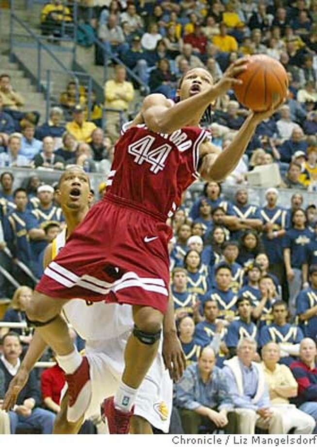Event at Berkeley on 2/14/04.  stanford's #44 Fred Washington goes up for a score during the 1st half. Cal's # 3 Dominic McGuire watches in the background.  Cal bears play the Stanford Cardinals at Berkeley.  Liz Mangelsdorf/ The Chronicle Stanford's Fred Washington takes it to the hoop in the first half. MANDATORY CREDIT FOR PHOTOG AND SF CHRONICLE/ -MAGS OUT Photo: LIZ MANGELSDORF