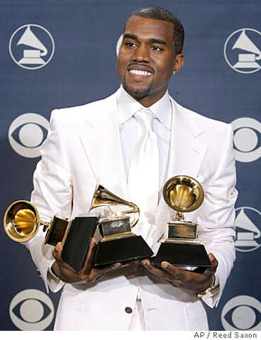482d543fea8 Kanye West poses with his three awards at the 47th Annual Grammy Awards on  Sunday,