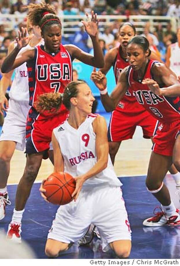 ATHENS - AUGUST 27: Tatiana Shchegoleva of Russia looks to pass whilst on her knees during the women's basketball semifinal game on August 27, 2004 during the Athens 2004 Summer Olympic Games at the Indoor Hall of the Olympic Sports Complex in Athens, Greece. (Photo by Chris McGrath/Getty Images) *** Local Caption *** Tatiana Shchegoleva (CHINA OUT until Sep 12th 2004) (NEWSWEEK, US NEWS & WORLD REPORT OUT until Sep 12th 2004) Photo: Chris McGrath