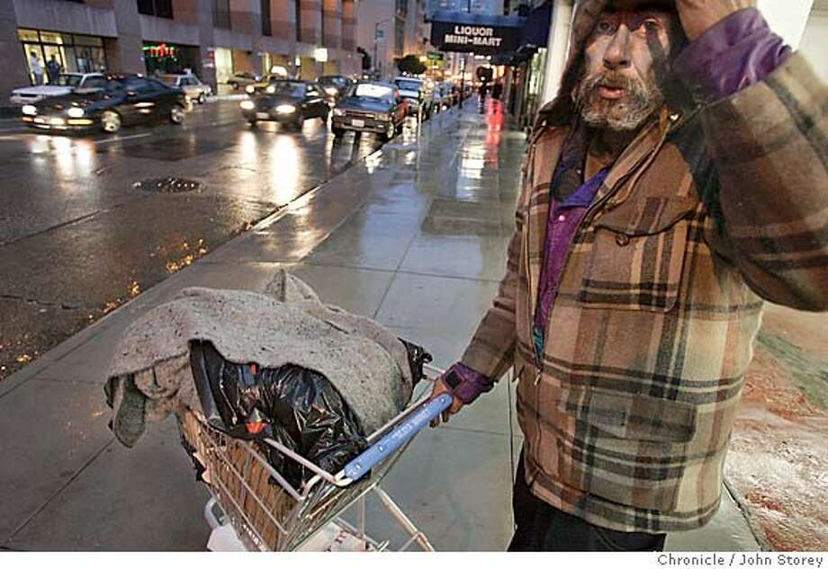 Homeless_146_jrs.jpg  Homeless person Thomas Valerio walks the Ellis street with his shopping cart.  Homeless on the streets of San Francisco. Story about the count of the homeless. John Storey San Francisco, CA. 2/14/05 San Francisco, CA John Storey/The Chronicle MANDATORY CREDIT FOR PHOTOG AND SF CHRONICLE/ -MAGS OUT Photo: John Storey
