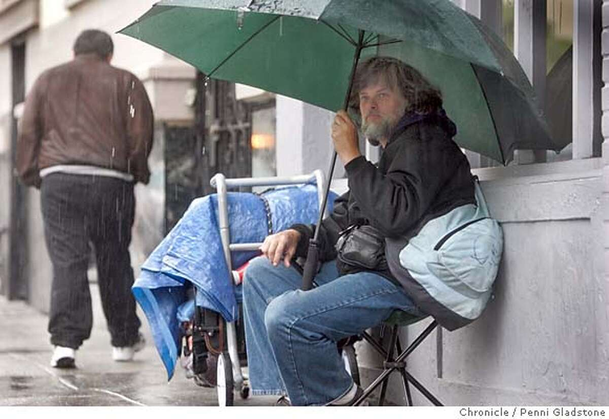 HOMELESS021PG.JPG Sitting in the rain, Robert Payne age 46 homeless for 1 yr. 3 months is from Oregon. Sleeps on street when sunny and seeks shelter other places in rain. STATs on homeless just came out. The San Francisco Chronicle, Penni Gladstone Photo taken on 2/14/05, in San Francisco,