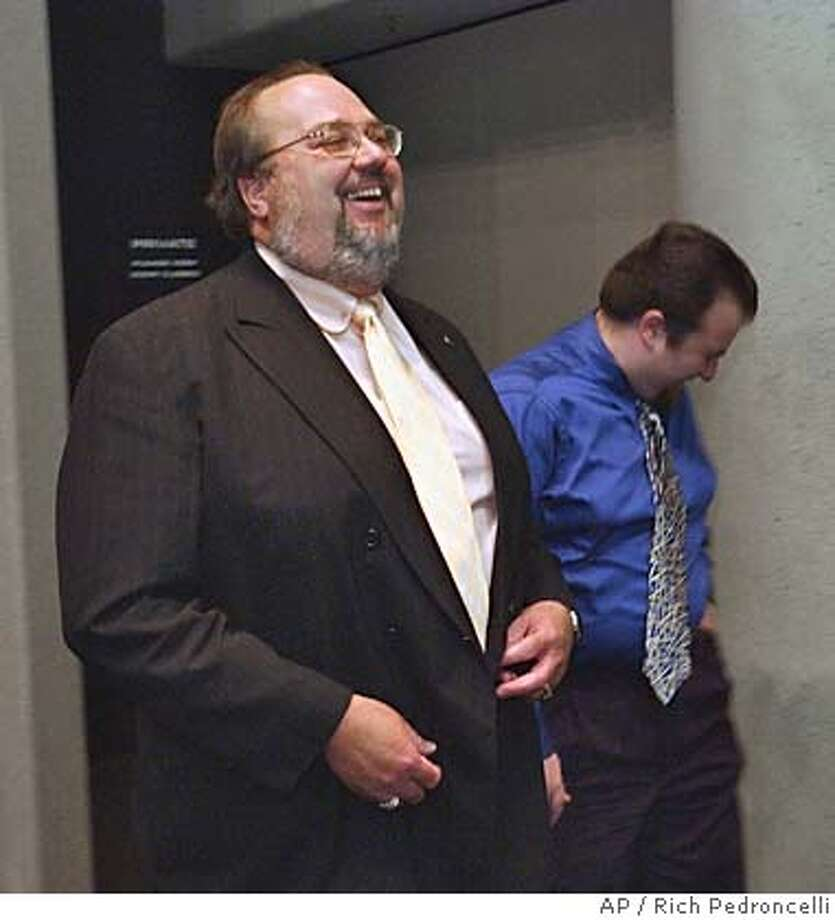 Rob Feckner, left, who was just elected California Employees Retirement System board president, laughs at a comment made by his son, Carl Baughman, right, as they leave the CalPERS board meeting in Sacramento, Calif., Wednesday Feb. 16, 2005. By a 12-0 vote Feckner, 47, a 27-year school employee and statewide union official, replaces Sean Harrigan, who was ousted in December (AP Photo/Rich Pedroncelli) Photo: RICH PEDRONCELLI