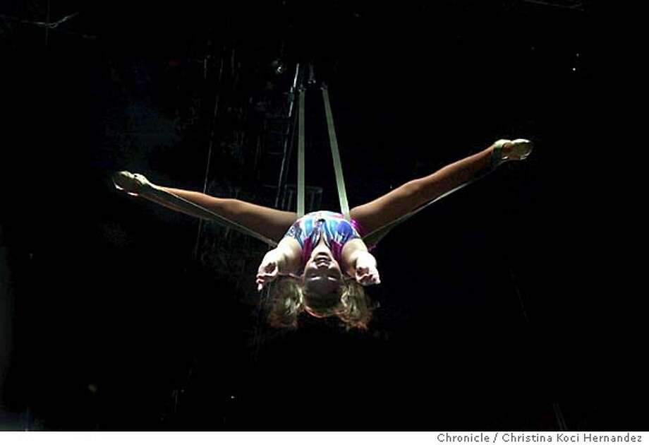 Aerialist, Shirley Larible, during the the Three-Ring Adventure. Sixteen year old Jeannie Psomas is going to the circus for the Chronicle. She will get a tour of the animal compound with Adam Murdoch and will go and partake in the Three-Ring Adventure, an interactive moment at the circus for paying customers. We want shots of Murdoch, people participating in the Adventure and other scene setting photos for this account of the circus.  Photo taken on 8/22/04 in Oakland, ca. Photo by Adam Traum/San Francisco Chronicle Photo: CHRISTINA KOCI HERNANDEZ