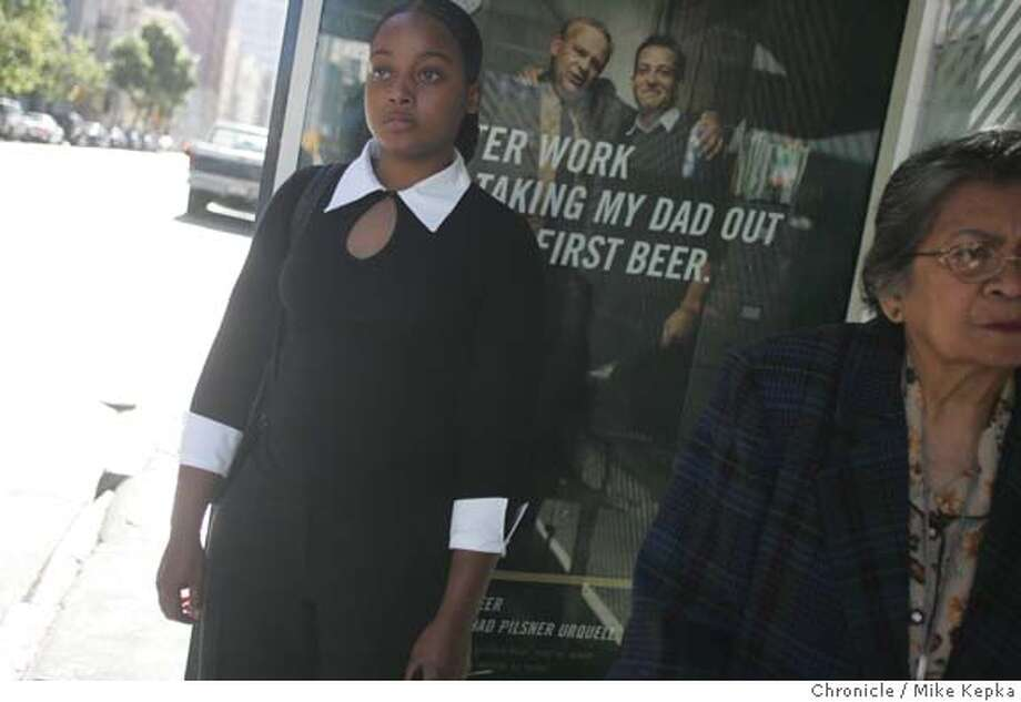 Carlene Wilson, 24, waits for the bus to take her home after after a job interview for a security monitor position. Wilson has been looking for work for several months and fears she will not be able to continue to live on her own apartment.  MIKE KEPKA/The Chronicle Photo: MIKE KEPKA