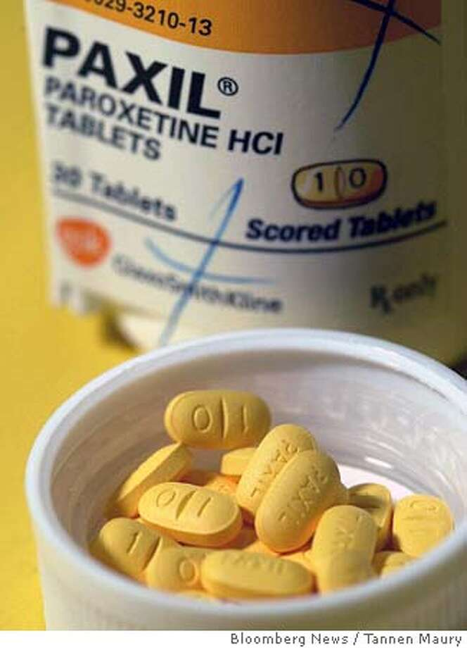 Tablets of the anti-depressant drug Paxil are shown in a drugstore in Wilmette, Illinois on Monday, December 30, 2002. GlaxoSmithKline Plc, Europe's largest drugmaker, said fourth-quarter profit dropped 16 percent and predicted a ``challenging'' 2004 as its former top-selling depression medicine Paxil lost sales to cheaper generic copies. Photographer: Tannen Maury/Bloomberg News Photo: TANNEN MAURY