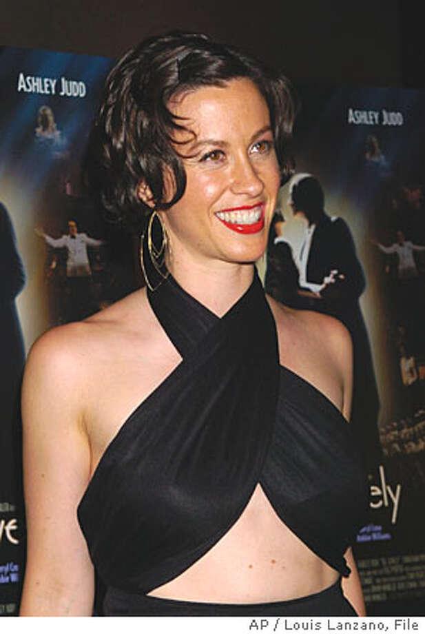 "** FILE ** Singer Alanis Morissette arrives for the New York premiere of ""De-Lovely"" in a file photo from June 21, 2004. Morissette is now an American citizen. (AP Photo/Louis Lanzano, File) Photo: LOUIS LANZANO"
