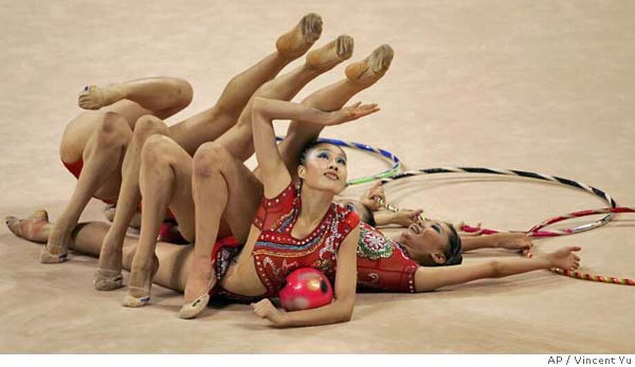 China team perform during the group all-around qualification of the rhythmic gymnastic at the 2004 Olympic Games in Athens, Thursday, Aug. 26, 2004. (AP Photo/Vincent Yu) Photo: VINCENT YU