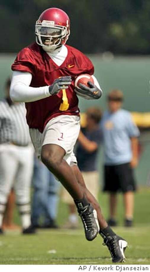 ** FILE ** Southern California wide receiver Mike Williams runs with the ball after catching it during practice in this Aug. 4, 2004 photo, at the Los Angeles campus. Southern California wide receiver Mike Williams has had his request to be reinstated denied Thursday by the NCAA. (AP Photo/Kevork Djansezian) A AUG. 4, 2004 FILE PHOTO Photo: KEVORK DJANSEZIAN