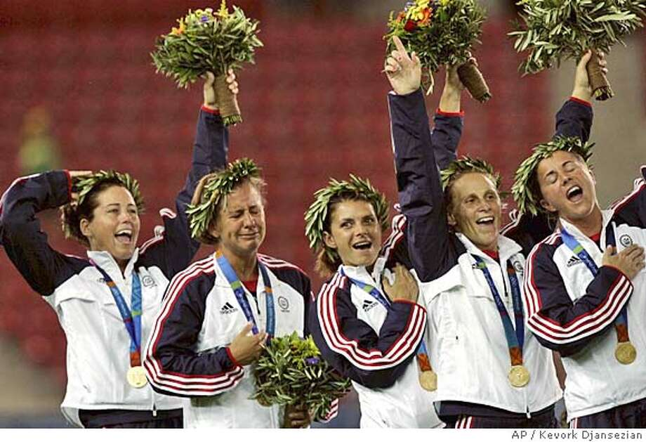 USA's players from left: Jullie Foudy, Joy Fawcett, Mia Hamm, Kristine Lilly, Brandi Chastain wave during the medal ceremony after the gold medal women soccer game between USA and Brazil for the Athens 2004 Olympics at the Karaiskaki stadium in Athens, on Thursday Aug. 26, 2004. USA won 2-1. (AP Photo/Kevork Djansezian) Photo: KEVORK DJANSEZIAN