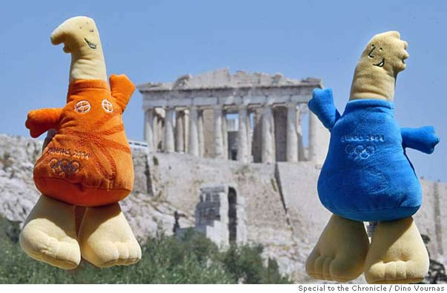 26olymascots2.jpg 8/25/04  The 2004 Athens Olympics mascots, Athena (left) and Phevos, shown next to the Parthenon, were patterned after ancient Greek children's dolls from the 7th Century B.C.. PHOTO ILLUSTRATION BY Dino Vournas/ Special To The Chronicle Photo: Dino Vournas