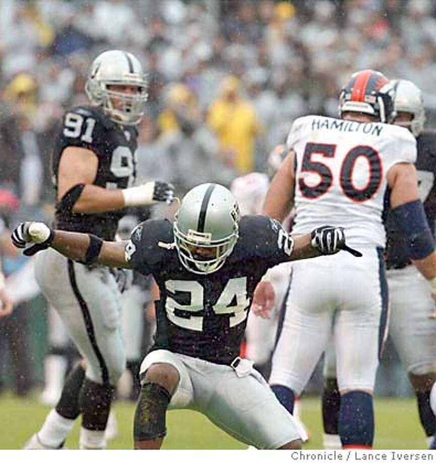 RAIDERS01_27_LI.jpg  Raiders Charles Woodson celibrates after sacking Bronocs QB Jake Plummer in first half action. Denver won 22-8.  BY LANCE IVERSEN/SAN FRANCISCO CHRONICLE Photo: LANCE IVERSEN