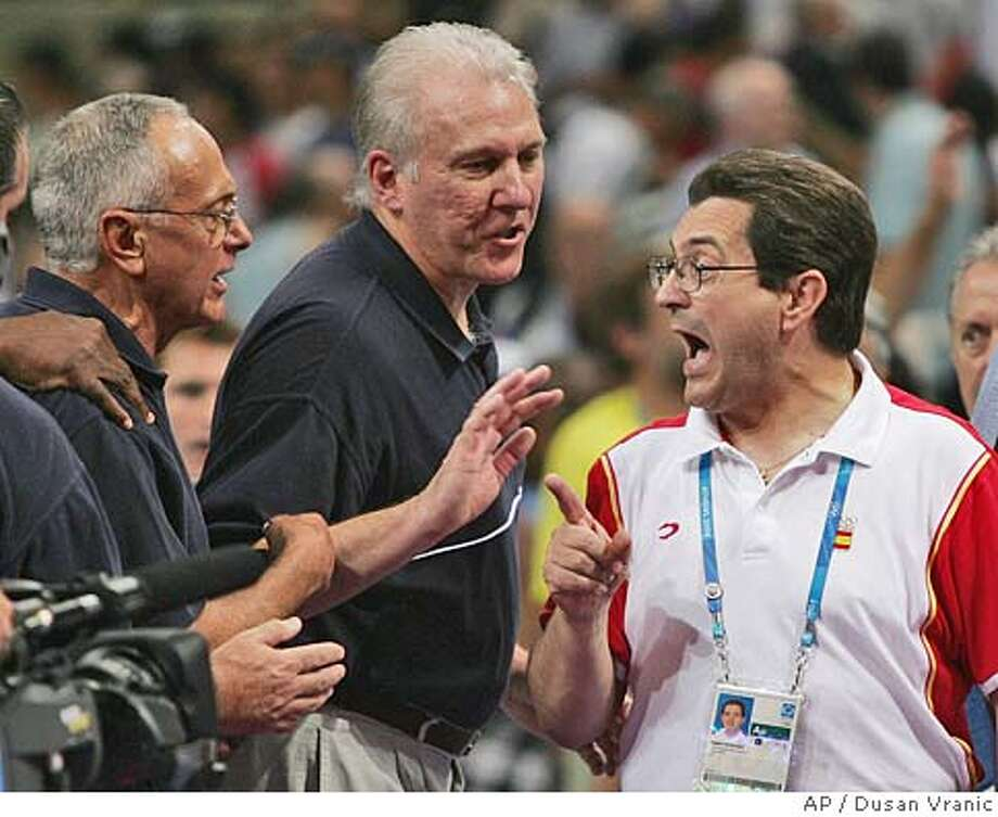 USA basketball coach Larry Brown, left, is confronted by Spain's coach Mario Pesquera, right, at the conclusion of their quarterfinal game at the Olympic Indoor Hall during the 2004 Olympics in Athens, Greece on Thursday, Aug. 26, 2004. The USA won 102-94. (AP Photo/Dusan Vranic) Photo: DUSAN VRANIC