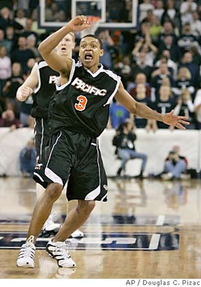 ** CORRECTS ID TO GUARD MIKE WEBB, NOT CENTER CASS MATHEUS ** Pacific guard Mike Webb reacts to his team's come from behind win over Utah State Saturday, Feb. 12, 2005, in Logan, Utah. Pacific beat Utah State, 64-63. (AP Photo/Douglas C. Pizac) Photo: DOUGLAS C. PIZAC