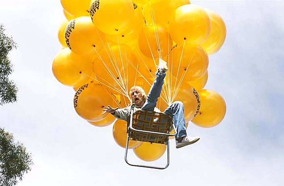 "An Australian cement truck driver, Danny (Rhys Ifans), decides to try to escape his life in the drabness of the city after a fight with his girlfriend (Clarke) prevents him from taking a long-awaited vacation. Tying large helium-filled balloons to his deckchair (ie, a lawn chair), Danny sails away into the sky, in ""Danny Deckchair."" (Lions Gate Films/ Lisa Tomasetti) Datebook#Datebook#Chronicle#08/16/2004#ALL#5star##0422243692 Photo: LISA TOMASETTI"