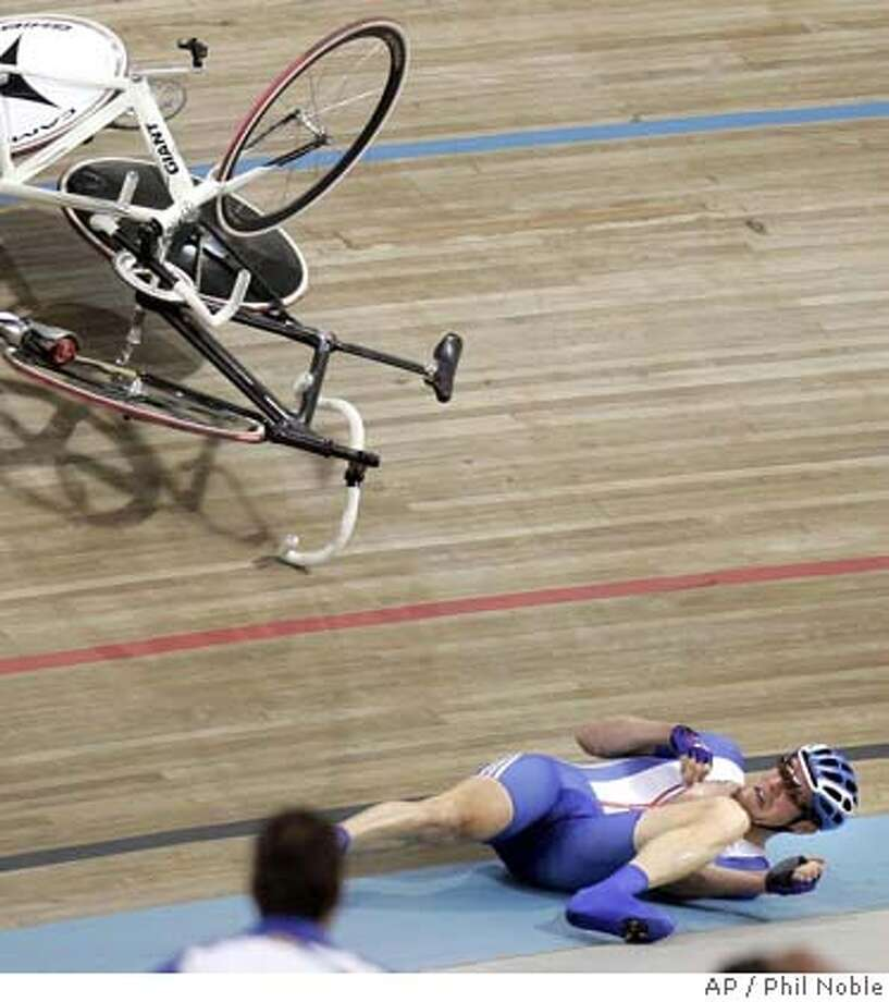 Great Britain's Rob Hayles takes a tumble during the Track Cycling Men's Madison race at the Olympic velodrome in Athens, Greece, Wednesday Aug 25 2004, during the 2004 Olympic Games. Hayles and team mate Bradley Wiggins finished third picking up a bronze medal. (AP Photo/PA, Phil Noble) ** UNITED KINGDOM OUT NO MAGS ** UNITED KINGDOM OUT NO MAGS Photo: PHIL NOBLE
