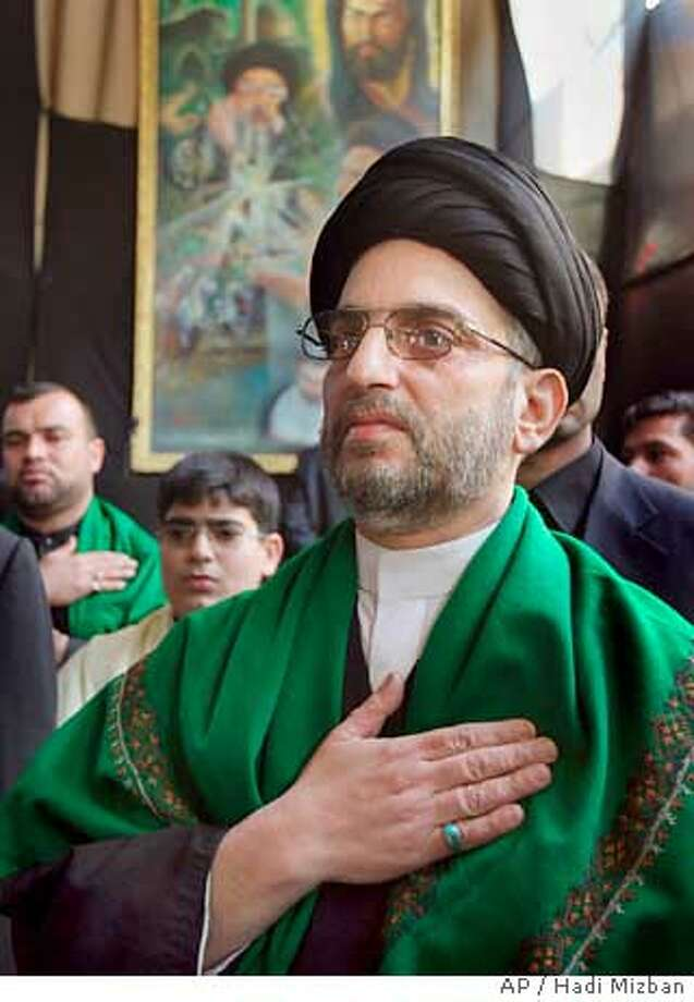 Abdul-Aziz al-Hakim, the pro-Iranian cleric who headed the Shiite ticket that won Iraq's national elections, at his headquarters in Baghdad, Iraq Monday, Feb. 14, 2005. Talks on who would get what in Iraq's newly-elected National Assembly were underway even before the final results came in, but the clergy-backed Shiites, whose winning margin was less than what they expected, may now have to compromise more than anticipated. (AP Photo/Hadi Mizban) Photo: HADI MIZBAN