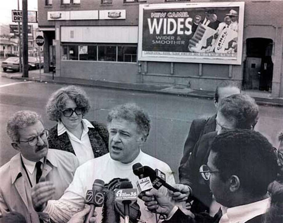 """Alameda County Supervisor Don Perata, center was joined by Augie Scornaienchi, Superintendent from the office of Education and Susan Kazan from the Cancer Society to launch a consumer boycott of Camel cigarettes to protest the """"Joe Camel"""" advertising campaign. 3/20/92"""