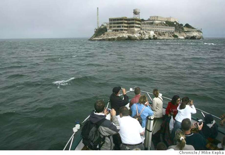 """Tourists to San Francisco ride under the Golden Gate Bridge and and around the Alcatraz Island on Captain Frank's fishing the """"Lovely Martha.""""  MIKE KEPKA/The Chronicle Photo: MIKE KEPKA"""