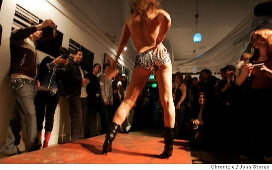 Clubland_300_jrs.jpg  Eve Baron works as a model during the fashion show for the crowd.  The Clubland feature in Style visits Club Six in San Francisco.  John Storey San Francisco, CA. 2/4/05 San Francisco, CA John Storey/The Chronicle MANDATORY CREDIT FOR PHOTOG AND SF CHRONICLE/ -MAGS OUT Photo: John Storey