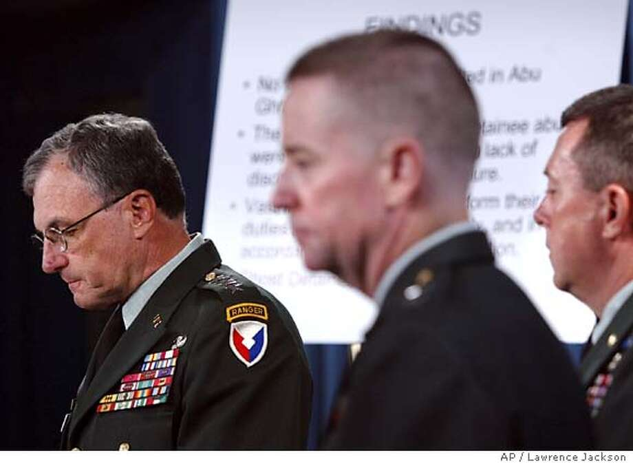 "Gen. Paul Kern , left, Maj. Gen. George R. Fay, center, and Lt. Gen. Anthony Jones, right, talk with reporters about the ""serious misconduct and a loss of moral values"" pertaining to the military personel at Abu Ghraib prison at the Pentagon, Wednesday, Aug. 25, 2004, in Washington. Twenty-seven people attached to an intelligence unit at Abu Ghraib prison near Baghdad either approved or participated in the abuse of Iraqi prisoners, an Army investigation found. (AP Photo/Lawrence Jackson)"