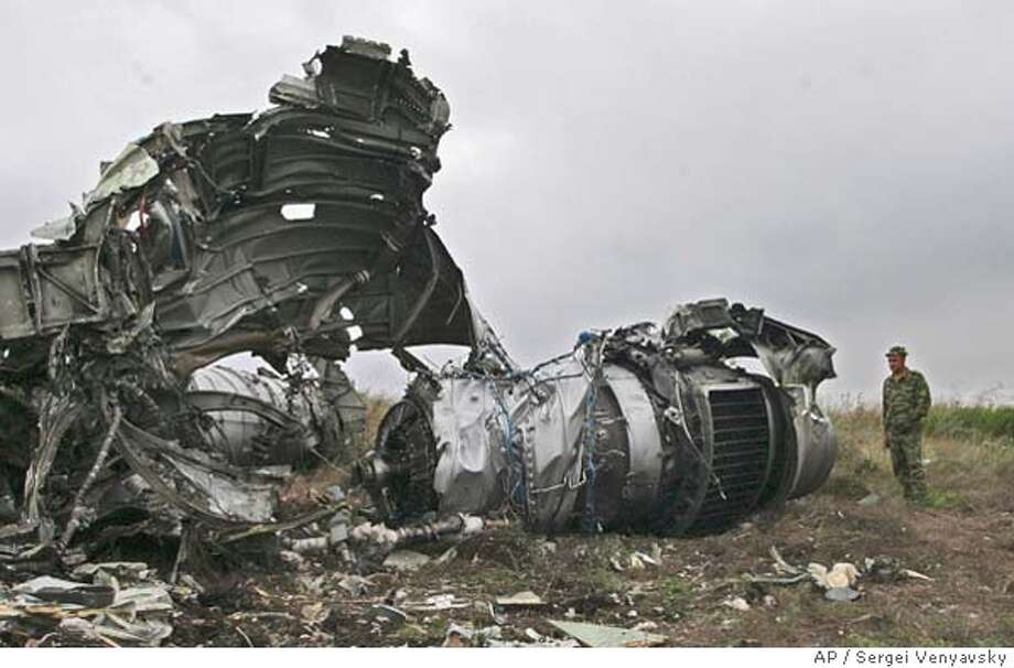 Wreckage of a Tu-154 airliner is seen at a crash site near Gluboky in the Rostov region some 1,000 kilometers (600 miles) south of Moscow, Tuesday, Aug. 25, 2004. Russian official said Wednesday that studies of the wreckage of the two planes have shown no terrorist act was carried out aboard two planes that crashed nearly simultaneously, killing all 89 people aboard both aircraft. (AP Photo/Sergei Venyavsky) Photo: SERGEI VENYAVSKY