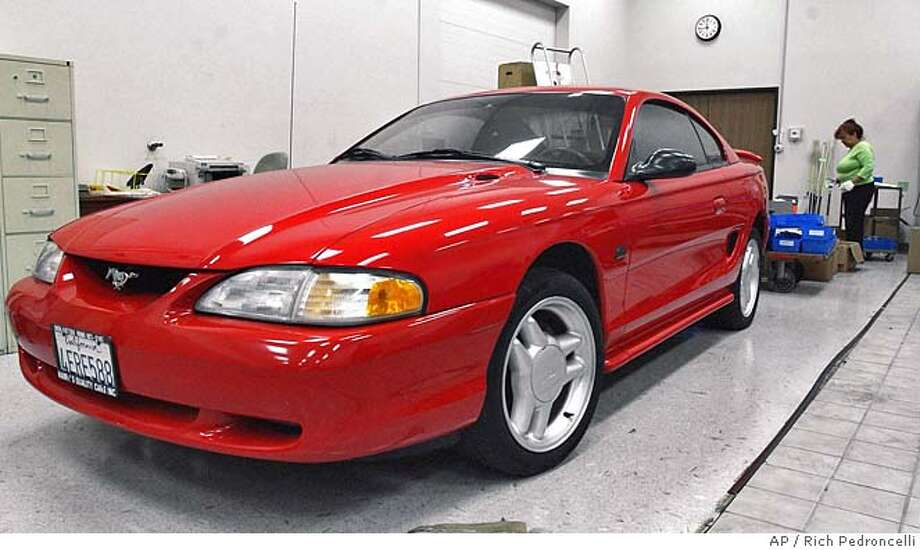 A 1995 Ford Mustang, seized by the South Lake Tahoe Police, seen at the state Department of General Services warehouse in Sacramento, Calif., Wednesday, Aug. 25, 2004., is among the items that will be put up for sale by the state. In an effort to rid the state of surplus items, the DGS will hold a giant sale for the public Friday and Saturday.(AP Photo/Rich Pedroncelli) Photo: RICH PEDRONCELLI