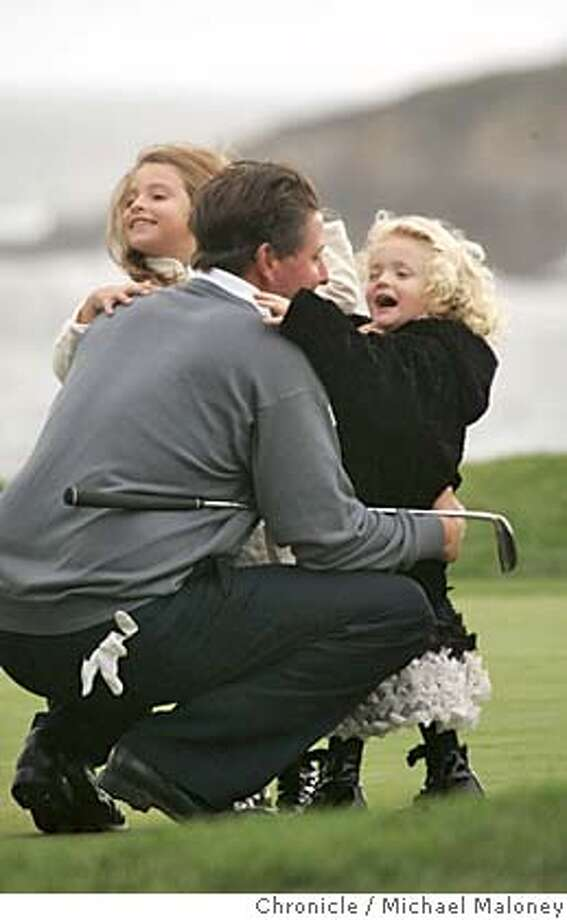 Phil Mickelson gets a hug from daughters Amanda (5) (left) and Sophia (3).  Third day of the AT&T Pebble Beach National Pro-Am Golf Tournament.  Photo by Michael Maloney / San Francisco Chronicle Photo: Michael Maloney