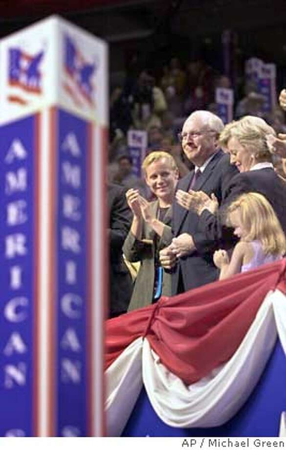 Dick Cheney, the choice of George W. Bush for vice-presidential nominee, attends the Republican National Convention with his family in Philadelphia Monday evening, July 31, 2000. Cheney's daughter, Mary, is at left, wife Lynne at right, and granddaughter at right. (AP Photo/Michael Green) CAT Photo: MICHAEL GREEN