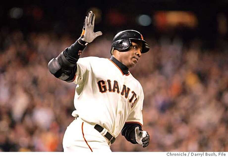 Barry Bonds may be chasing history, but the steroids issue will be dogging him all season. Chronicle file photo by Darryl Bush